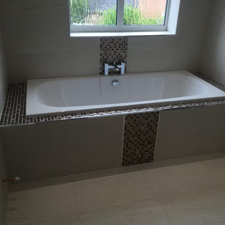 Glass mosaic around bathin Rotherham by Andy coldwell - Tiling excellence